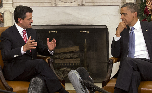 President Barack Obama listens as Mexican President-Elect Enrique Peña Nieto speaks prior to their meeting in the Oval Office of the White House in Washington, Tuesday, November 27, 2012.