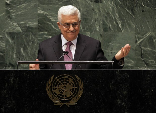 Palestinian President Mahmoud Abbas acknowledges applause before he addresses the U.N. General Assembly on November 29, 2012.