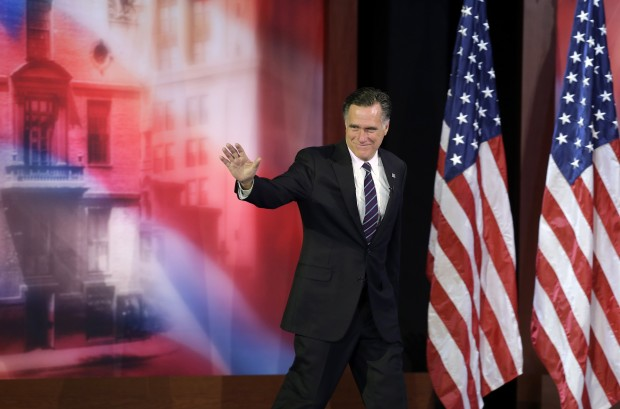 Former Massachusetts Gov. Mitt Romney waves to supporters before conceding the 2012 presidential race.