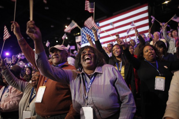 Supporters of President Barack Obama react to favorable media projections at the McCormick Place during an election night watch party in Chicago on election night.