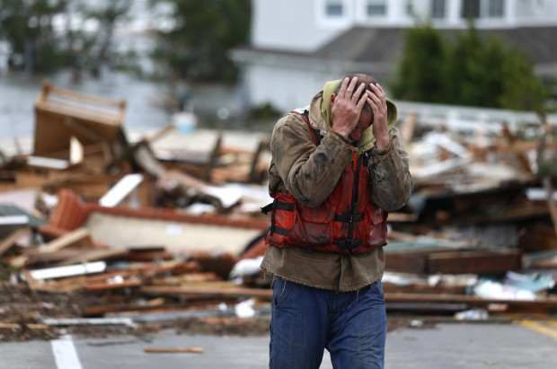Man reacting to home washed up after Superstorm Sandy
