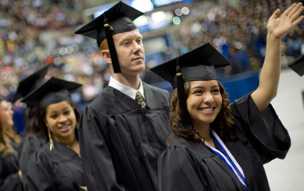 A group of students walks into an auditorium to attend University of Connecticut's 2012 graduation ceremonies. College education rates, among other factors laid out in this report, are signs of economic mobility and opportunity.