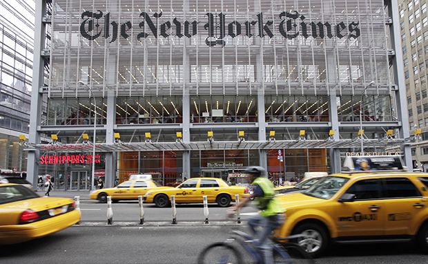 Traffic passes the New York Times building in New York, Tuesday, October 18, 2011.