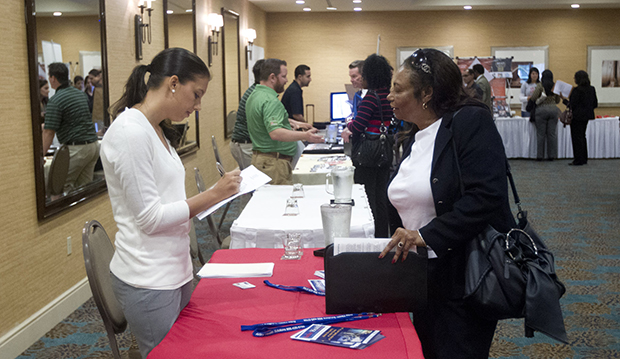 A person fills out an application at the Fort Lauderdale Career Fair in Dania Beach, Florida, Friday, November 30, 2012.