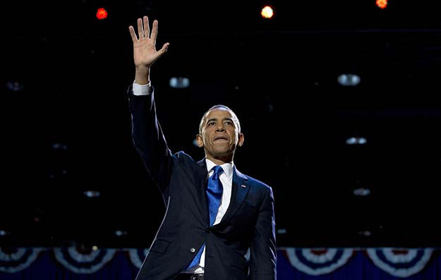 President Barack Obama waves to supporters at the election night party, Wednesday, November 7, 2012, in Chicago, to proclaim victory in the presidential election.