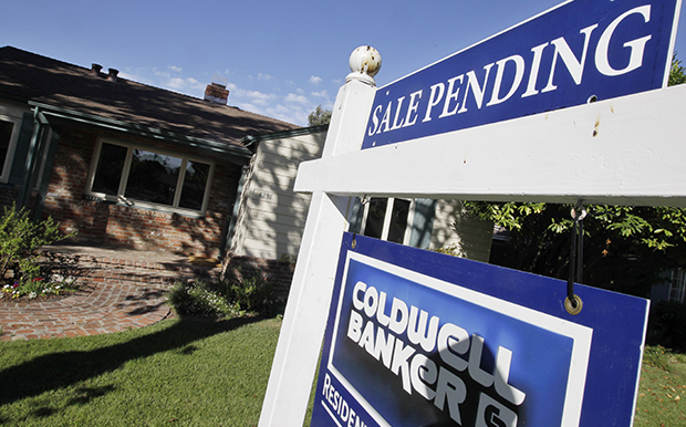 A house with a pending home sale sign is seen in Palo Alto, California.