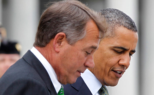 President Barack Obama talks with House Speaker John Boehner (R-OH) on Capitol Hill. Congress must extend unemployment insurance despite the ongoing fiscal showdown and budget cuts that will likely take effect in January.
