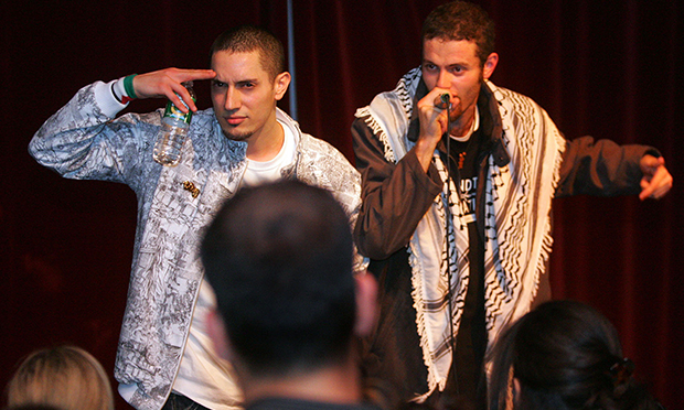 Omar Chakaki, left, whose performance alias is Omar Offendum, and Nizar Wattad, who goes by the name Ragtop, perform at the Coda lounge, Thursday, March 16, 2006, in New York.