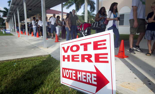 People stand in line to vote early on Sunday, October 28, 2012, in Pembroke Pines, Florida.