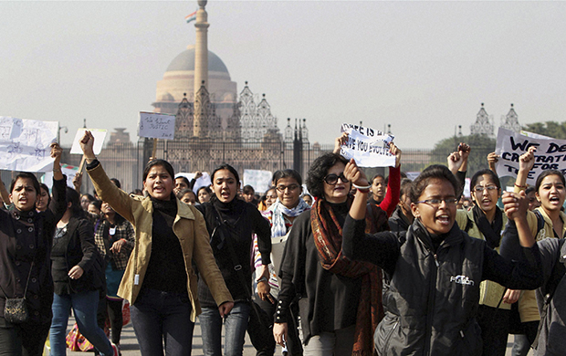 Activists of the All India Democratic Women's Association and Young Women's Christian Association, or YWCA, students shout slogans as they take part in a protest march from the Presidential Palace to India Gate in New Delhi, India, Friday, December 21, 2012.