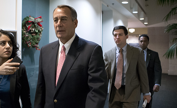 Speaker of the House John Boehner (R-OH) walks to a closed-door GOP caucus as Congress meets to negotiate a legislative path to avoid the so-called fiscal cliff of automatic tax increases and deep spending cuts that could kick in January 1, at the Capitol in Washington, Sunday, December 30, 2012.