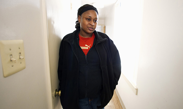 In this photo taken Friday, March 9, 2012, homeless veteran Misha McLamb, 32, talks in her transition home in the Adams Morgan neighborhood of Washington.