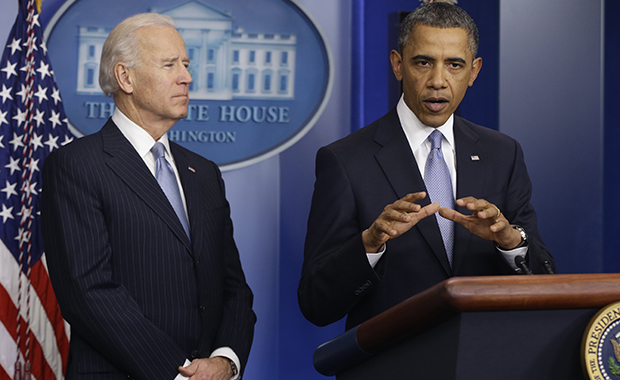 President Barack Obama and Vice President Joe Biden make a statement regarding the passage of the fiscal cliff bill in the Brady Press Briefing Room at the White House in Washington, Tuesday, January 1, 2013.