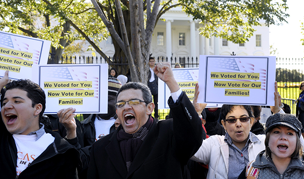 Gustavo Torres, director, Casa in Action, center, and others chant during a rally of immigration rights organizations in front of the White House in Washington, Thursday, November 8, 2012, calling on President Barack Obama to fulfill his promise of passing comprehensive immigration reform.