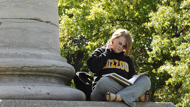 University of Missouri senior Kristen Overmyer studies on the columns on the Columbia, Missouri, campus Friday, September 28, 2007. Overmyer, a journalism student, didn't take out enough student loans during her freshman year and so turned to credit cards, compounding her debt.
