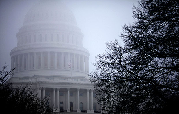 Fog obscures the Capitol dome on Capitol Hill in Washington on Monday, December 10, 2012. The resolution of the fiscal showdown allowed the economy to keep growing in January, but more needs to be done to help the economy.