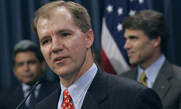 Don Willett, foreground, speaks after Texas Gov. Rick Perry (R), right, announced that Willett was named to the Texas Supreme Court on Wednesday, August 24, 2005, in Austin, Texas.