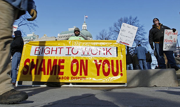 Ben Fairchild of Decatur, Indiana, displays a sign outside of the Statehouse in Indianapolis on January 4, 2012.