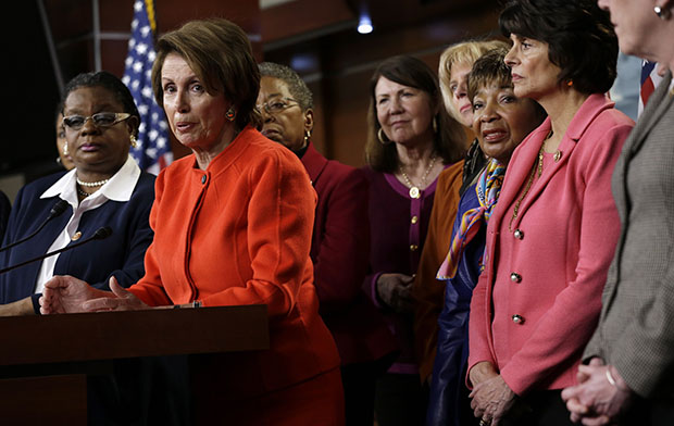 House Minority Leader Nancy Pelosi (D-CA), center, accompanied by fellow House Democrats, leads a news conference on Capitol Hill in Washington, Wednesday, January 23, 2013, to discuss the reintroduction of the Violence Against Women Act.