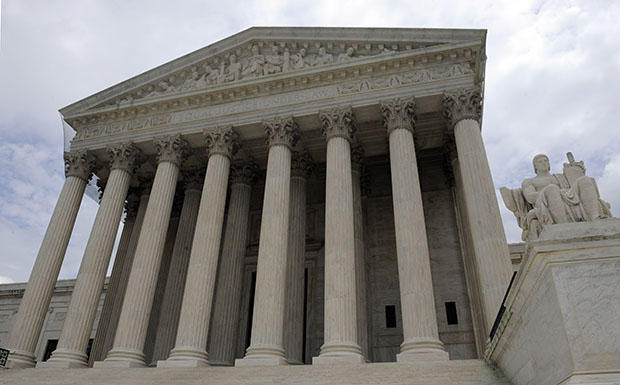 The U.S. Supreme Court is seen in Washington. Under the caps imposed by the Budget Control Act, federal discretionary spending on law enforcement and justice will fall below 0.3 percent of GDP by 2017. This category includes federal efforts aimed at crime prevention and investigation, border protection and immigration enforcement, the federal prison system, and U.S. attorneys and the federal courts, including the Supreme Court.