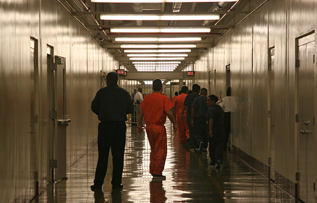 Detainees at Immigration and Customs Enforcement's Stewart Detention Center in Lumpkin, Georgia, leave the cafeteria after lunch to go back to their living units. Gay and transgender immigrants can face particularly harsh treatment in detention centers.