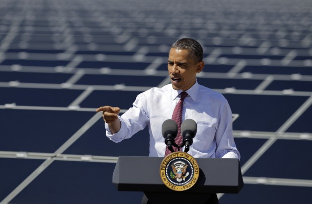 President Obama speaks in front of solar panels