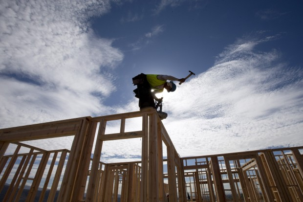 Construction worker working on a house in California