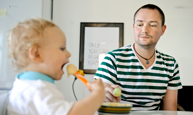 A father on workplace leave feeds his son in Stockholm, Sweden. The Family and Medical Leave Act was a good start for supporting workers and workplace fairness, but it needs to include more workers.