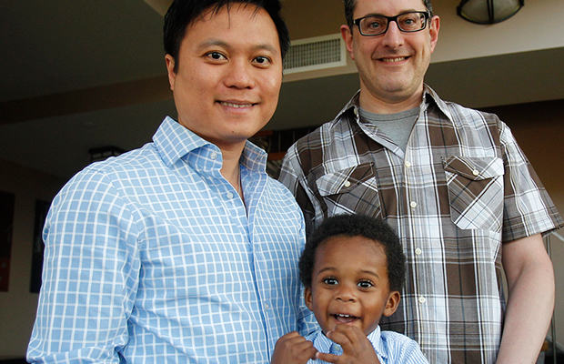 Jonathan Truong, left, his partner Ed Cowen, right, and their son Franklin Cowen Truong, 2, pose for a picture at their home in Brooklyn, New York. The Family and Medical Leave Act falls short of protecting gay and transgender workers and their families.