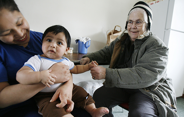 Nancy Sabin visits with a mother and child in Highgate, Vermont, Thursday, March 5, 2009. The Family and Medical Leave Act has certainly helped American workers, but many workers of color, who experience disproportionate rates of economic insecurity, are either ineligible or unable financially to take leave under the law.
