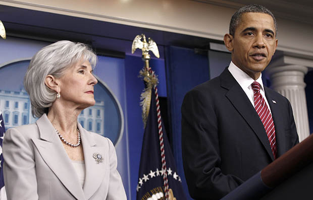 President Barack Obama, accompanied by Health and Human Services Secretary Kathleen Sebelius, announces the revamp of his contraception policy requiring religious institutions to fully pay for birth control, Friday, February 10, 2012, in the Brady Press Briefing Room of the White House in Washington.
