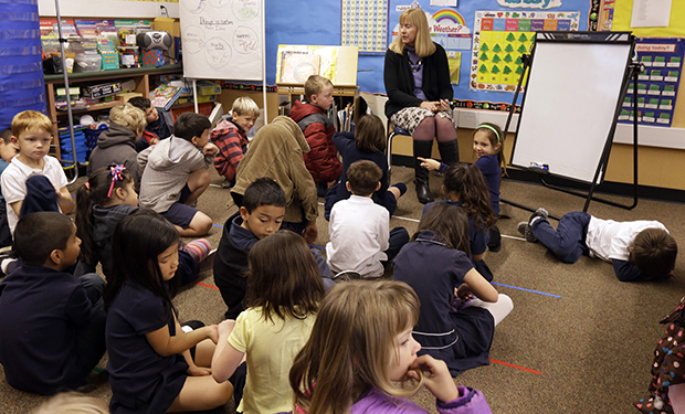 First grade teacher Lynda Jensen teaches her class of 30 children, Thursday, January 24, 2013, at the Willow Glenn Elementary School in San Jose, California.