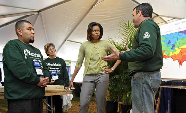 First Lady Michelle Obama visits students with the YouthBuild AmeriCorps community service program who gathered on the National Mall in Washington to celebrate their 30th anniversary by building an affordable, energy-efficient house, in Washington, Tuesday, March 17, 2009.