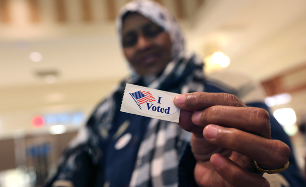 "Addey Munye, 67, shows off her ""I Voted"" sticker after casting her ballot in her first election at a polling station in the West Acres Mall in Fargo, North Dakota, on November 6, 2012."