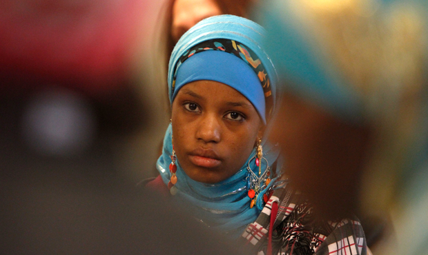 Barwako Abayle, an immigrant student from Burlington High School, listens during a meeting with lawmakers about racial inequality at her school on April 26, 2012 in Montpelier, Vermont.