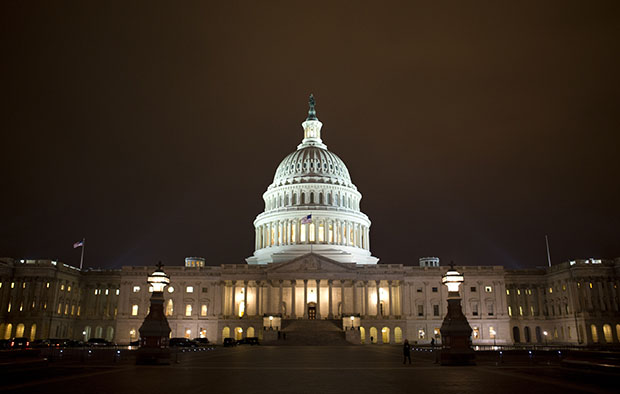 The lights of the U.S. Capitol remain lit into the night on Tuesday, January 1, 2013.
