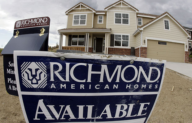A sign promotes the availability of a new home in Aurora, Colorado, on Sunday, August 19, 2007.