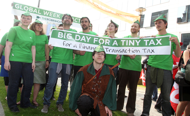 Campaigners and European trade unions dress as Robin Hood while calling on European Union leaders to go ahead with a financial transaction tax to mobilize money to help poor people hit by the economic crisis, in front of the European Council building in Brussels on May 23, 2012.