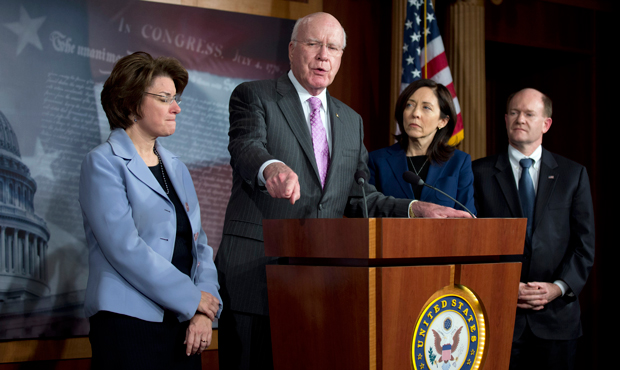 Senate Judiciary Committee Chairman Patrick Leahy (D-VT), second from left, the lead author of the Violence Against Women Reauthorization Act, joined by, from left, Sens. Amy Klobuchar (D-MN), Maria Cantwell (D-WA), and Christopher Coons (D-DE), speaks during a news conference on Capitol Hill in Washington, following the Senate's passage of the Violence Against Women Reauthorization Act, February 12, 2013.