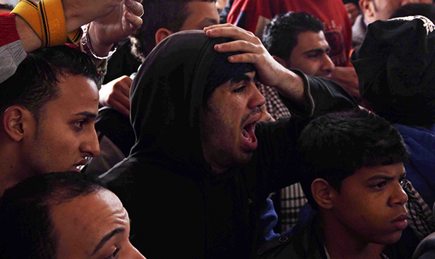 Families and supporters of those accused of soccer violence from the Port Said soccer club react to the announcement of verdicts for 21 fans on trial in last year's Port Said stadium incident which left 74 people dead, in Port Said, Egypt, Saturday, January 26, 2013.