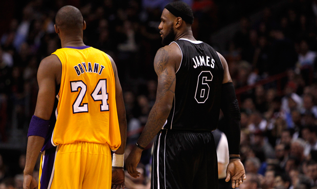 Miami Heat's LeBron James speaks with Los Angeles Lakers' Kobe Bryant during a game on January 19, 2012. The media's stereotypical portrayals of race have obscured reality in sports.