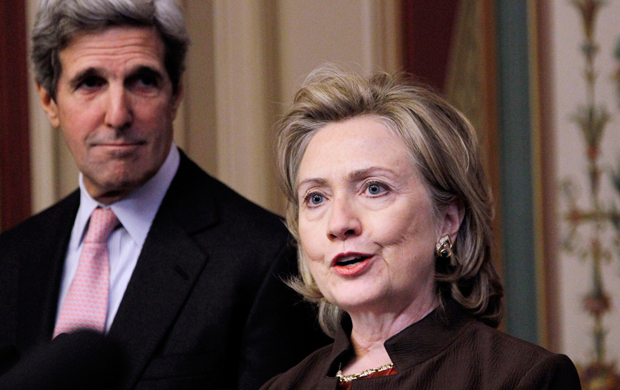 Then-Secretary of State Hillary Clinton, right, accompanied by then-Senate Foreign Relations Committee Chairman Sen. John Kerry (D-MA), left, talks about the START Treaty on Capitol Hill in Washington, November 17, 2010.