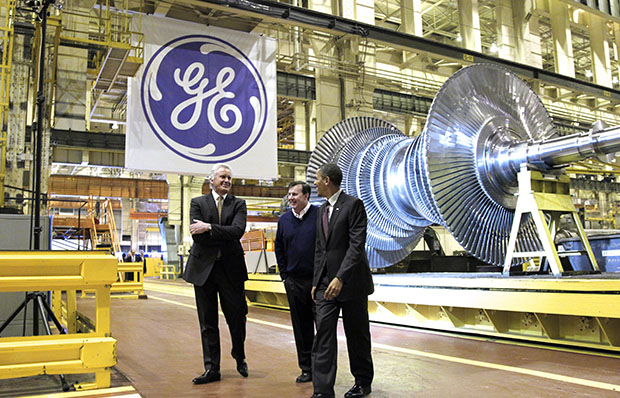 President Barack Obama, joined by General Electric CEO Jeffrey Immelt, left, and Plant Manager Kevin Sharkey, center, visits a GE plant in Schenectady, New York, to talk about clean energy and green jobs, Friday, January 21, 2011.