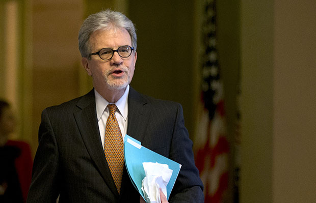 Sen. Tom Coburn (R-OK) walks toward the Senate chamber on Capitol Hill in Washington, December 31, 2012.