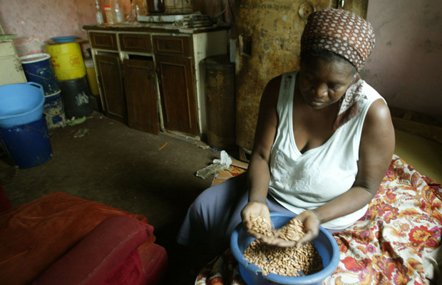 Faustine Janjira prepares food at her home in Highfields, a high-density suburb of Harare, Zimbabwe, October 17, 2006. Janjira, who lives with her sisters and their 10 children in a two-room house, struggles to feed the big family as only one member of the family works.
