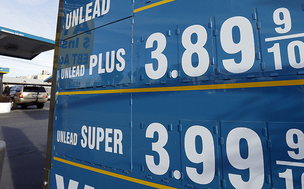Gasoline prices are displayed as a motorist refuels his vehicle, Friday, February 1, 2013, in Oakland, California.