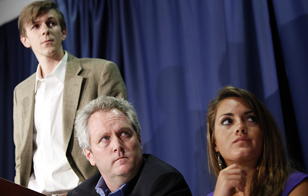 Andrew Breitbart, center, flanked by James O'Keefe III, left, and Hannah Giles, takes part in a news conference, Wednesday, October 21, 2009, at the National Press Club in Washington.