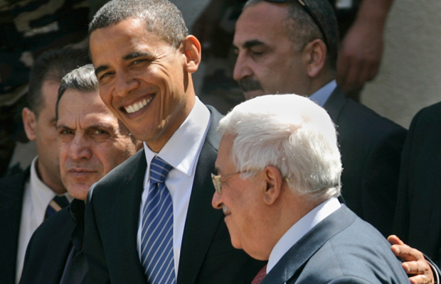 Then-U.S. Democratic presidential candidate Sen. Barack Obama (D-IL), left, walks with Palestinian President Mahmoud Abbas, right, as he leaves following a meeting at Abbas' headquarters in the West Bank town of Ramallah, July 23, 2008.