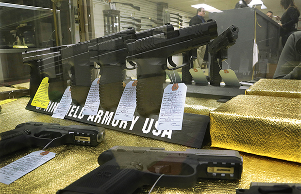 Handguns are seen for sale at Capitol City Arms Supply, Wednesday, January 16, 2013, in Springfield, Illinois.