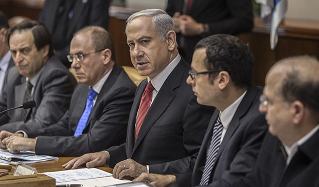 Israeli Prime Minister Benjamin Netanyahu, center, chairs the weekly cabinet meeting in his Jerusalem offices, Sunday, February 3, 2013.